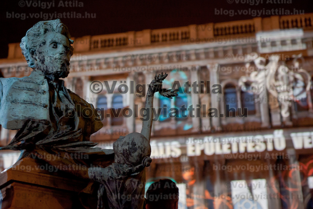 A statue is seen during the light painting show displayed on the front of the Hungarian Science Academy building during the Hungarian rotational EU presidency closing celebrations in Budapest, Hungary on June 26, 2011. ATTILA VOLGYI