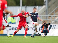Rangers Kris Boyd and Falkirk's David McCracken. Falkirk 0 v 2 Rangers, Scottish Championship game played 15/8/2014 at The Falkirk Stadium.