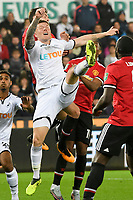 Football - 2017 / 2017 EFL (League) Cup - Fourth Round: Swansea City vs. Manchester United<br /> <br /> Alfie Mawson of Swansea City leaps for the ball , at The Liberty Stadium.<br /> <br /> COLORSPORT/WINSTON BYNORTH