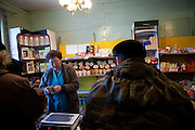 The Pole of Cold. Shop assistant and customers at the only shop for groceries in the village of Oymyakon. The area is extremely cold during the winter. Two towns by the highway, Tomtor and Oymyakon, both claim the coldest inhabited place on earth (often referred to as -71.2°C, but might be -67.7°C) outside of Antarctica. The average temperature in Oymyakon in January is -42°C (daily maximum) and -50°C (daily minimum). Oymyakon, Oimjakon, Yakutia, Jakutien, Russian Federation, Russia, RUS, 20.01.2010