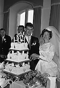 """05/09/1962<br /> 09/05/1962<br /> 05 September 1962<br /> Wedding of Fergus Keogh of """"Eagleville"""", Strandville Avenue, Clontarf, Dublin to Miss Miriam Caffrey, Church Avenue, Drumcondra Dublin at the Church of the Visitation of the BVM, Fairview with reception at St. Lawrence Hotel, Howth. Mr. keogh was full-back for Bective Rangers at the time. Cutting the cake!"""