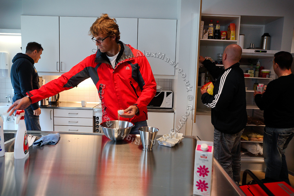Inmates are preparing some food in one of the common kitchen and living room areas established to be a meeting point between inmates and guards and to facilitate rehabilitation inside the luxurious Halden Fengsel, (prison) near Oslo, Norway.
