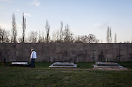Michael, a Syrian-Armenian from Aleppo, reading tomb stones at Armenian genocide memorial in Yerevan. Michael came to Armenia from Syria in October 2012 and now works as a taxi driver, after a sucessful career in graphic design in Syria.
