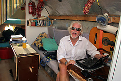06 April 2011. St Maarten, Antilles, Caribbean.<br /> Crew member John Russell<br /> Crew of the Antiki raft arrive in the islands following their epic 9 week trans-Atlantic journey from the Canary islands.  Conditions aboard the very cramped 'Antiki'. The toilet ('room with a view'), shower, emergency raft on the raft! And the cramped living quarters, bunks, radio and satellite equipment, books, cooking facilities, and personal effects.<br /> Crew; Anthony Smith (84 yrs old) British adventurer, John Russell, solicitor and UK resident, David Hildred, sailing master and British Virgin Islands resident,  Dr Andrew Bainbridge of Alberta, Canada.<br /> Photo; Charlie Varley/varleypix.com