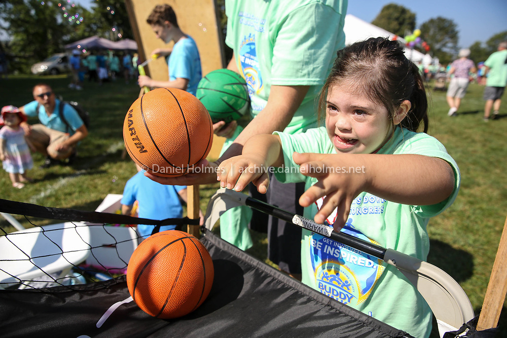 (9/17/17, WESTBOROUGH, MA) Sydney Loop, 7, of North Andover, shoots some baskets during the Annual Westborough Buddy Walk and Harvest Fair  at Lake Chauncey in Westborough on Sunday. [Daily News and Wicked Local Photo/Dan Holmes]