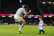 Argentina's Juan Martin Fernandez Lobbe celebrates with his children at the end of the match after his team win to reach the semi-finals. Rugby World Cup 2015 quarter-final match, Ireland v Argentina at the Millennium Stadium in Cardiff, South Wales  on Sunday 18th October 2015.<br /> pic by  Andrew Orchard, Andrew Orchard sports photography.