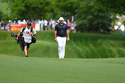 May 3, 2019 - Charlotte, NC, U.S. - CHARLOTTE, NC - MAY 03: Patrick Reed tops the hill along side his caddie on the eleventh fairway in round two of the Wells Fargo Championship on May 03, 2019 at Quail Hollow Club in Charlotte,NC. (Photo by Dannie Walls/Icon Sportswire) (Credit Image: © Dannie Walls/Icon SMI via ZUMA Press)