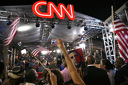 Crowd gathered at the CNN set behind the on-air commentators in an effort to get on camera. On-site at the Democratic National Convention, Invesco Field at Mile High Stadium, August 28, 2008.