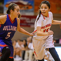Gallup Bengal Camille Ettcity (15) breaks around Las Cruces Bulldawg Jayden Perez (5) Saturday at Gallup High School.