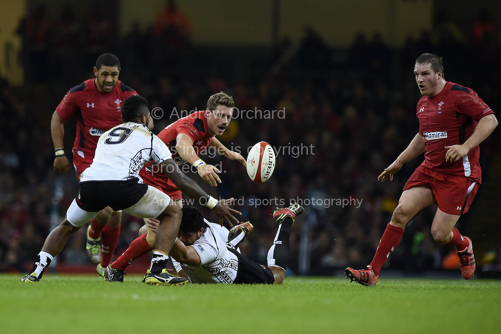 Rhys Priestland of Wales (c)  is stopped. Dove Men series 2014, autumn international rugby, Wales v Fiji at the Millennium Stadium in Cardiff, South Wales on Saturday 15th November 2014.<br /> pic by Andrew Orchard, Andrew Orchard sports photography.