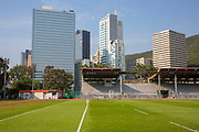 Aberdeen Sports Ground being overlooked by high-rise buildings on Wong Chuk Hang Road, Hong Kong. The buildings include (from left to right): One Island South, L'Hotel, and the Gee Chang Hong centre.  (photo by Andrew Aitchison / In pictures via Getty Images)