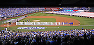 Oct 21, 2014; Kansas City, MO, USA; San Francisco Giants and Kansas City Royals players line up for the national anthem before game one of the 2014 World Series at Kauffman Stadium. Mandatory Credit: Peter G. Aiken-USA TODAY Sports