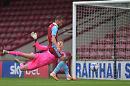 Andy Dales (17) of Scunthorpe United misses a chance to score past Louis Jones of Doncaster Rovers u23 during the Pre-Season Friendly match between Scunthorpe United and Doncaster Rovers at Glanford Park, Scunthorpe, England on 15 August 2020.