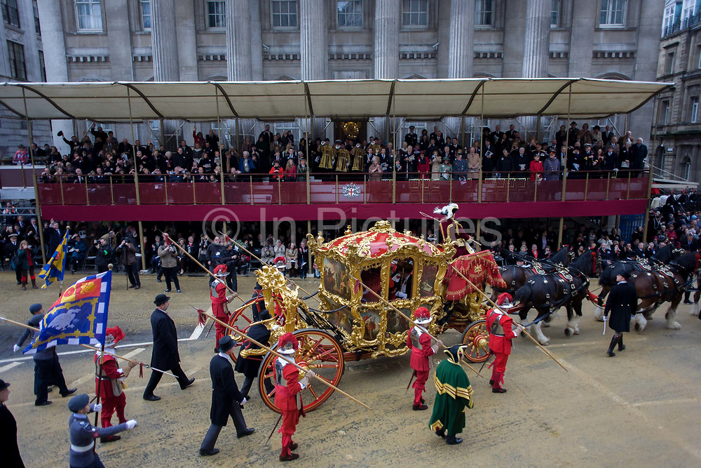The Lord Mayor's carriage arrives at Mansion House during the Lord Mayor's Show in the City of London. Alderman and Rt Hon The Lord Mayor of London, Roger Gifford, a merchant banker with Swedish bank SEB is the 685th in the City of London's ancient history. The new Mayor's procession consists of a 3-mile, 150-float parade of commercial and military organisations going back to medieval times. This is the oldest and longest civic procession in the world that has survived the Plague and the Blitz, today one of the best-loved pageants. Henry Fitz-Ailwyn was the first Lord Mayor (1189-1212) and ever since, eminent city fathers (and one woman) have taken the role of the sovereign's representative in the City – London's ancient, self-governing financial district. The role ensured the King had an ally within the prosperous enclave.