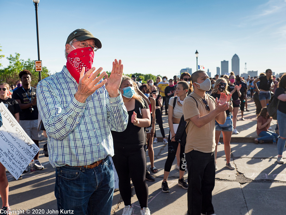 01 JUNE 2020 - DES MOINES, IOWA: FRANK COWNIE, (left) the Mayor of Des Moines, stands in the crowd of Black Lives Matter protesters at the Iowa State Capitol Monday. About 1,000 people gathered in front of the Iowa State Capitol in Des Moines Monday evening for a rally calling for racial justice. The rally was one week after George Floyd, an unarmed black man, was killed by a Minneapolis police officer who knelt on Floyd's back for more than eight minutes. There were protests  in Des Moines all weekend against Floyd's killing. There was some violence and some people have been arrested but the protests in Des Moines haven't been as serious as protests in other cities.          PHOTO BY JACK KURTZ