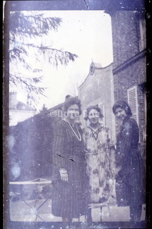 fading vintage image of three female friends together