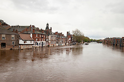 On the day the environment Agency announce there is no longer a drought in Yorkshire, this is the view from Bridgestreet, York looking down river toward Bishopsgate street where the Ouse river has risen flooding local roads and businesses after the wettest April since records began. .11  May 2012.Image © Paul David Drabble