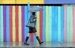 April 25, 2017 - Albuquerque, New Mexico, U.S. - Lorilynn Violanta walks along 2nd street and Sliver as rain hit the Albuquerque area. (Credit Image: © Jim Thompson/Albuquerque Journal via ZUMA Wire)