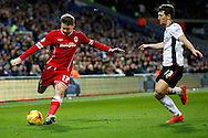 Aron Gunnarsson crosses the ball past Richard Smallwood of Rotherham. Skybet football league championship match, Cardiff city v Rotherham Utd at the Cardiff city stadium in Cardiff, South Wales on Saturday 6th December 2014<br /> pic by Mark Hawkins, Andrew Orchard sports photography.