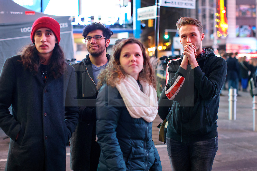 © Licensed to London News Pictures. 09/11/2016. New York CIty, USA. People watch Donald Trump's first speech as the next president of the United States, while gathering in Times Square, New York City, on Wednesday, 9 November. Photo credit: Tolga Akmen/LNP