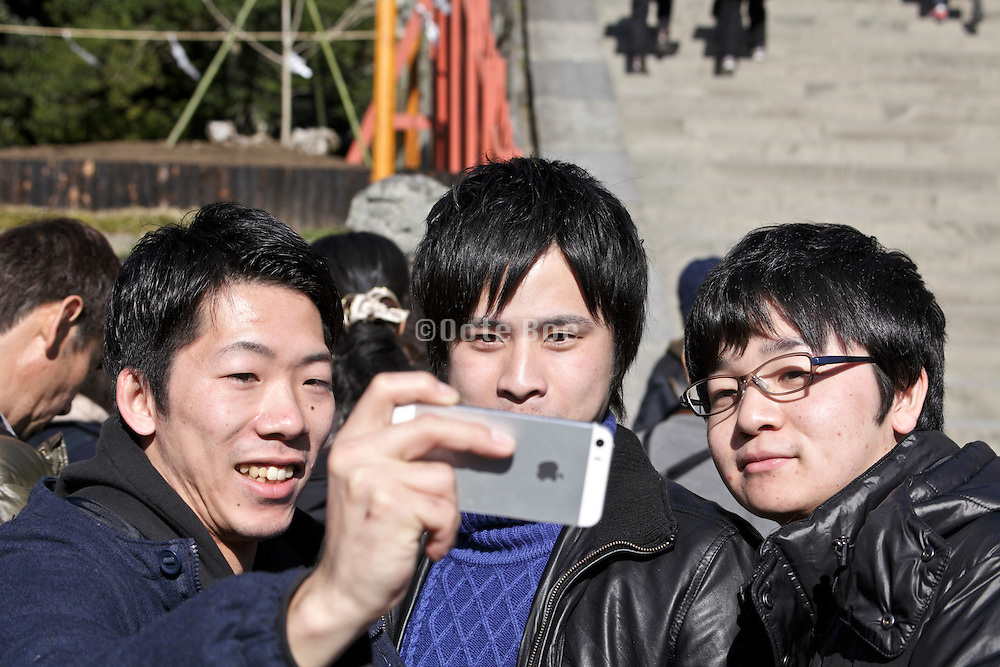 Japanese young adult friends making a selfie