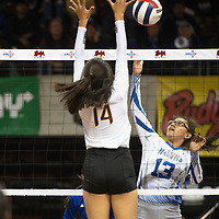 Laguna's Taya Kie (13) goes up for a spike in their match against Santa Fe Indian Thursday morning at the Santa Ana Star Center in the NMAA Class 3A State Volleyball tournament in Rio Rancho.