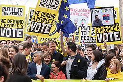 London, UK. 23rd March, 2019. Alastair Campbell and Mayor of London Sadiq Khan join a million people on the Put It To The People for a People's Vote march through central London before attending a rally in Parliament Square.