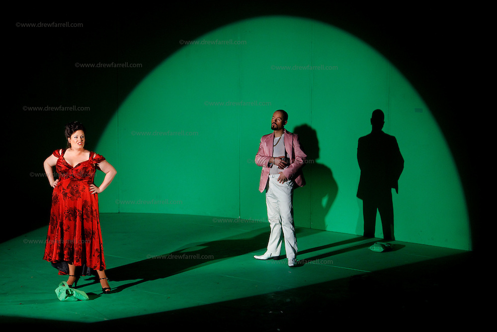 Picture shows : Karen Cargill as Isabella and Paul Carey Jones as Haly..Picture  ©  Drew Farrell Tel : 07721 -735041..A new Scottish Opera production of  Rossini's 'The Italian Girl in Algiers' opens at The Theatre Royal Glasgow on Wednesday 21st October 2009..(Soap) opera as you've never seen it before..Tonight on Algiers.....Colin McColl's cheeky take on Rossini's comic opera is a riot of bunny girls, beach balls, and small screen heroes with big screen egos. Set in a TV studio during the filming of popular Latino soap, Algiers, the show pits Rossini's typically playful and lyrical music against the shoreline shenanigans of cast and crew. You'd think the scandal would be confined to the outrageous storylines, but there's as much action off set as there is on.....Italian bass Tiziano Bracci makes his UK debut in the role of Mustafa. Scottish mezzo-soprano Karen Cargill, who the Guardian called a 'bright star' for her performance as Rosina in Scottish Opera's 2007 production of The Barber of Seville, sings Isabella..Cast .Mustafa...Tiziano Bracci.Isabella..Karen Cargill.Lindoro...Thomas Walker.Elvira...Mary O'Sullivan.Zulma...Julia Riley.Haly...Paul Carey Jones.Taddeo...Adrian Powter..Conductors.Wyn Davies.Derek Clarke (Nov 14)..Director by Colin McColl.Set and Lighting Designer by Tony Rabbit.Costume Designer by Nic Smillie..New co-production with New Zealand Opera.Production supported by.The Scottish Opera Syndicate.Sung in Italian with English supertitles..Performances.Theatre Royal, Glasgow - October 21, 25,29,31..Eden Court, Inverness - November 7. .His Majesty's Theatre, Aberdeen  - November 14..Festival Theatre,Edinburgh - November 21, 25, 27 ...Note to Editors:  This image is free to be used editorially in the promotion of Scottish Opera. Without prejudice ALL other licences without prior consent will be deemed a breach of copyright under the 1988. Copyright Design and Patents Act  and will be subject to payment or legal action, where appropriate..Furthe