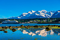 """Holland America Line's cruise ship """"Zaandam"""" in port at Haines, Alaska USA. Haines is surrounded by mountains and water. Rising high above the town are the Takinsha Mountains and Chilkat Range to the south, Takshanuk Mountains to the north and Coast Mountains to the east across the Lynn Canal."""