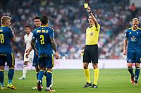 Referee show yellow card to Celta de Vigo's player Hugo Mallo during a match of La Liga Santander at Santiago Bernabeu Stadium in Madrid. August 27, Spain. 2016. (ALTERPHOTOS/BorjaB.Hojas)