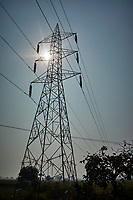 Power Lines and Sun Burst from a moving bus near Bharatpur, India. Image taken with a Nikon 1 V3 camera and 10-30 mm VR lens (ISO 200, 10.4 mm, f/10, 1/4000 sec)
