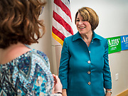 04 MAY 2019 - GRINNELL, IOWA: US Senator AMY KLOBUCHAR, (D-MN), right, greets voters after a campaign appearance before a crowd of about 150 people in a community room at Drake Community Library in Grinnell, IA. Sen. Klobuchar is touring Iowa Saturday to support her bid for the Democratic nomination of for the US Presidency in the 2020 election. Iowa traditionally hosts the the first election event of the presidential election cycle. The Iowa Caucuses will be on Feb. 3, 2020.      PHOTO BY JACK KURTZ