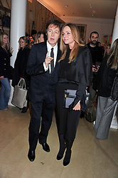 SIR PAUL McCARTNEY and his daughter STELLA McCARTNEY at a party to celebrate the switching on of the Christmas Lights at the Stella McCartney store, Bruton Street, London on 29th November 2011.