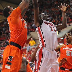 Rutgers Scarlet Knights guard/forward Dane Miller (11) grabs a rebound away from Syracuse Orange forward Kris Joseph (32) during second half NCAA Big East basketball action between #2 Syracuse and Rutgers at the Louis Brown Athletic Center. Syracuse defeated Rutgers 74-64.