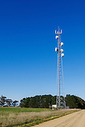 Rural cellular, microwave and communications antenna array for the mobile telephone system on a triangular lattice tower and equipment enclosure shelter in country Victoria, Australia. <br /> <br /> Editions:- Open Edition Print / Stock Image