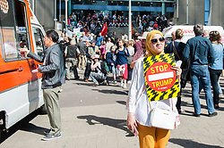 May 24, 2017 - Brussels, Belgium - Demonstrators gather to attend a protest against US President Donald Trump ahead of the meeting of NATO (North Atlantic Treaty Organization) heads of state and government, in Brussels, Belgium on May 24, 2017.  This is his first scheduled trip overseas that comes as European leaders remain anxious about whether the U.S. will continue its level of support for the 28-nation alliance. (Credit Image: © Romy Arroyo Fernandez/NurPhoto via ZUMA Press)