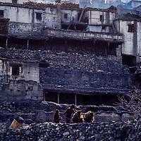 A weatherworn stone city in the arid, rainshadowed Muktinath Valley north of Annapurna in Nepal.