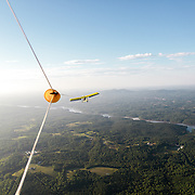 The view from under the canopy of the hang glider as its being towed by the Dragonfly over Footshills Regional Airport. Once the desired altitude is met, the hang glider pilot detaches the line and is free to glide safely to the ground.