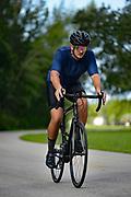 Man riding a road bike on curvy road
