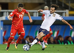 October 6, 2017 - Turin, Italy - Marco Parolo (R) of Italy national team and Enis Bardhi of FYR Macedonia national team vie for the ball during the 2018 FIFA World Cup Russia qualifier Group G football match between Italy and FYR Macedonia at Stadio Olimpico on October 6, 2017 in Turin, Italy. (Credit Image: © Mike Kireev/NurPhoto via ZUMA Press)