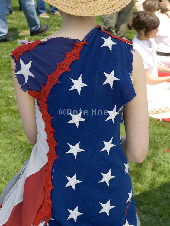 back of a woman dressed in an American flag outfit