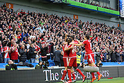 Middlesbrough fans celebrate the third goal by Middlesbrough FC striker Christian Stuani during the Sky Bet Championship match between Brighton and Hove Albion and Middlesbrough at the American Express Community Stadium, Brighton and Hove, England on 19 December 2015. Photo by Phil Duncan.