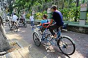 Tourist riding in a Cyclo (bicycle rickshaw), Ho Chi Minh City (Saigon), Vietnam