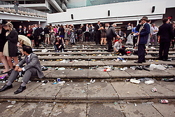 (c) under License to London News Pictures 02/11/2010.(c) under License to London News Pictures 02/11/2010. Young racegoers resting after a big day at the 2010 Melbourne cup
