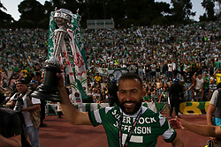 May 25, 2019 - Oeiras, Portugal - OEIRAS, PORTUGAL - MAY 25: Sporting's defender Jefferson from Brazil celebrates with the trophy after winning the Portugal Cup Final football match Sporting CP vs FC Porto at Jamor stadium, on May 25, 2019, in Oeiras, outskirts of Lisbon, Portugal. (Credit Image: © Pedro Fiuza/NurPhoto via ZUMA Press)