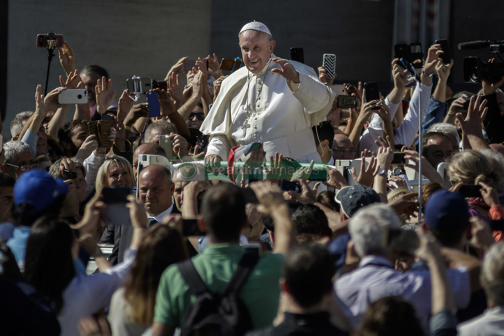 October 3, 2018 - Vatican City, Vatican - Pope Francis greets the faithful as he leaves at the end of a mass for the opening of the Synod of Bishops, focusing on Young People, the Faith and Vocational Discernment in St. Peter's Square in Vatican City, Vatican on October 03, 2018. (Credit Image: © Giuseppe Ciccia/Pacific Press via ZUMA Wire)