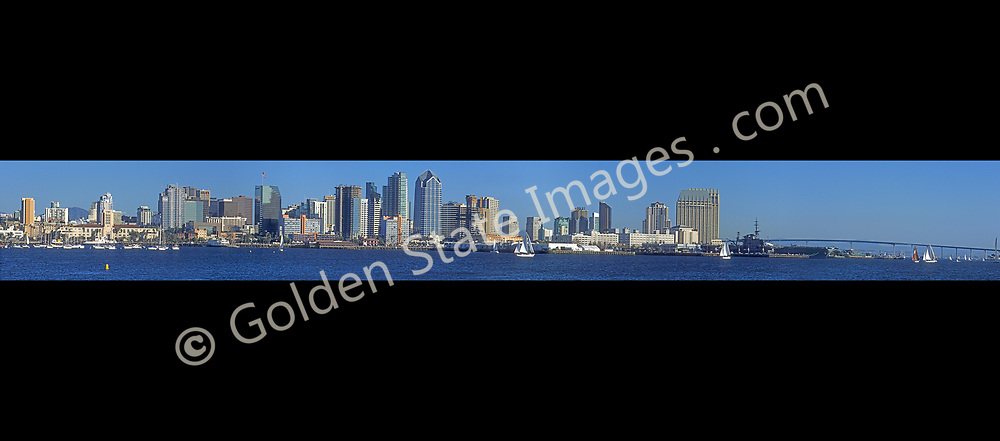 Ultra wide view of the downtown San Diego skyline including the Coronado Bridge and Midway Aircraft Carrier on the far right. <br /> <br /> Panoramic available up to 24832x2977 pixels.