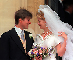 Lady Helen Windsor and her husband , Tim Taylor,  on the steps of St George's Chapel in Windsor Castle, after their wedding ceremony.