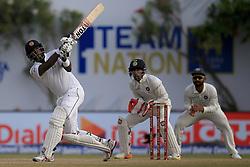 July 27, 2017 - Galle, Sri Lanka - Sri Lankan cricketer Angelo Mathews(L) plays a shot as Indian Wicket keeper Wriddhiman Saha(2R) looks on during  the 2nd Day's play in the 1st Test match between Sri Lanka and India at the Galle International cricket stadium, Galle, Sri Lanka on Thursday 27 July 2017. (Credit Image: © Tharaka Basnayaka/NurPhoto via ZUMA Press)