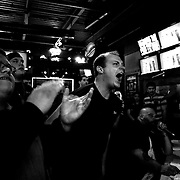 Competitors and fans react to competition during The 14th Annual CT Fall Classic, Arm Wrestling Challenge held at the City Sports Grille, Bristol, Connecticut, USA. 16th October 2013. Photo Tim Clayton